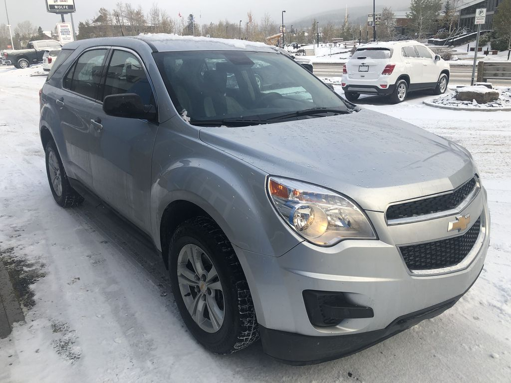 Silver[Silver Ice Metallic] 2012 Chevrolet Equinox LS Right Front Corner Photo in Canmore AB