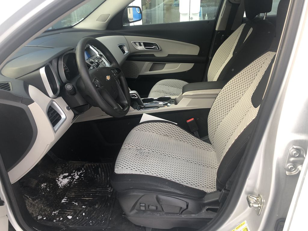 Silver[Silver Ice Metallic] 2012 Chevrolet Equinox LS Left Front Interior Photo in Canmore AB