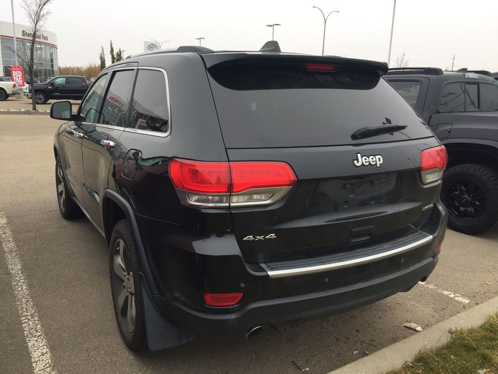 Green[Black Forest Green Pearlcoat] 2014 Jeep Grand Cherokee LIMITED / Panoramic Roof / 3.6L Left Rear Corner Photo in Sherwood Park AB