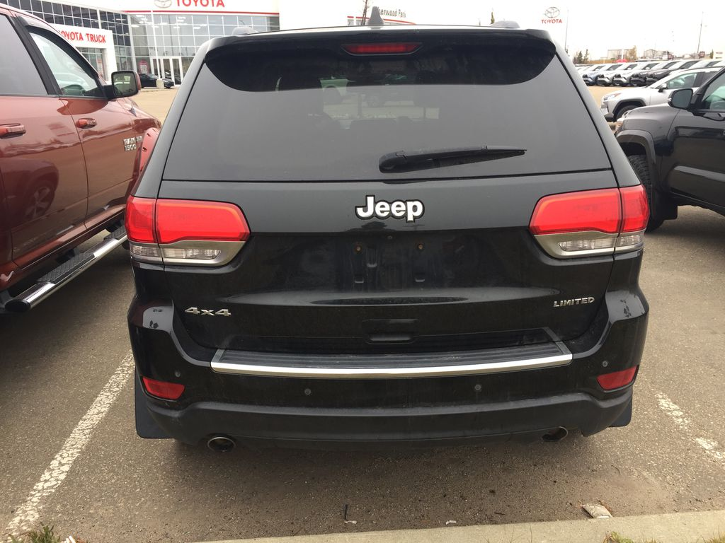 Green[Black Forest Green Pearlcoat] 2014 Jeep Grand Cherokee LIMITED / Panoramic Roof / 3.6L Rear of Vehicle Photo in Sherwood Park AB