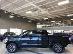 Midnight Black Metallic 2021 Toyota Tundra 4WD Crewmax TRD Off Road Left Side Photo in Edmonton AB