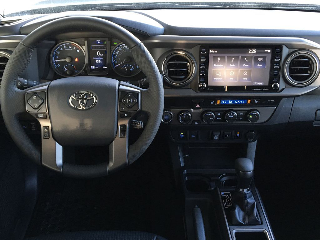 Gray[Cement] 2021 Toyota Tacoma 4WD Steering Wheel and Dash Photo in Kelowna BC