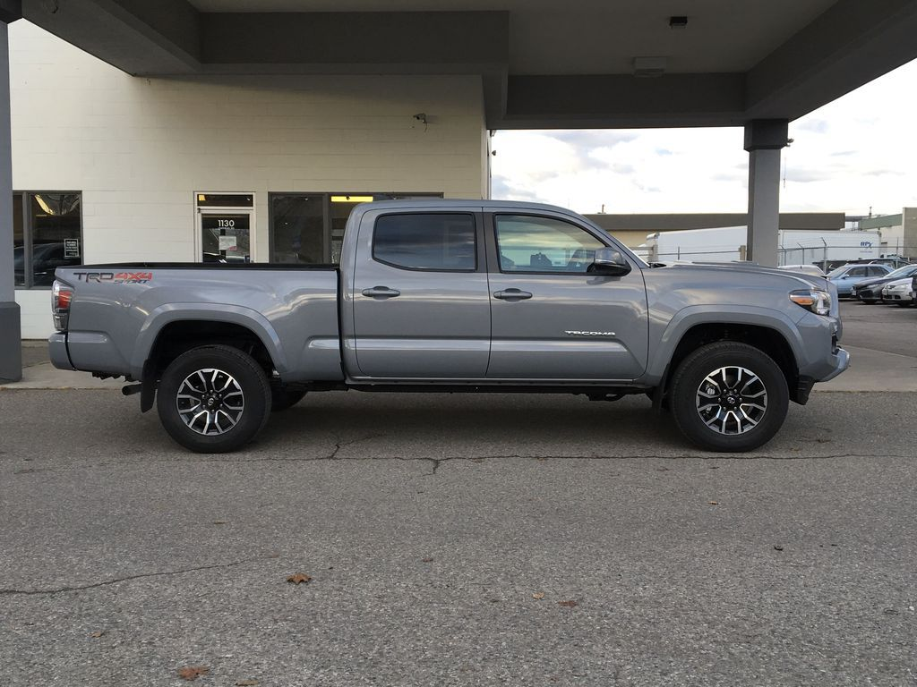Gray[Cement] 2021 Toyota Tacoma 4WD Right Side Photo in Kelowna BC