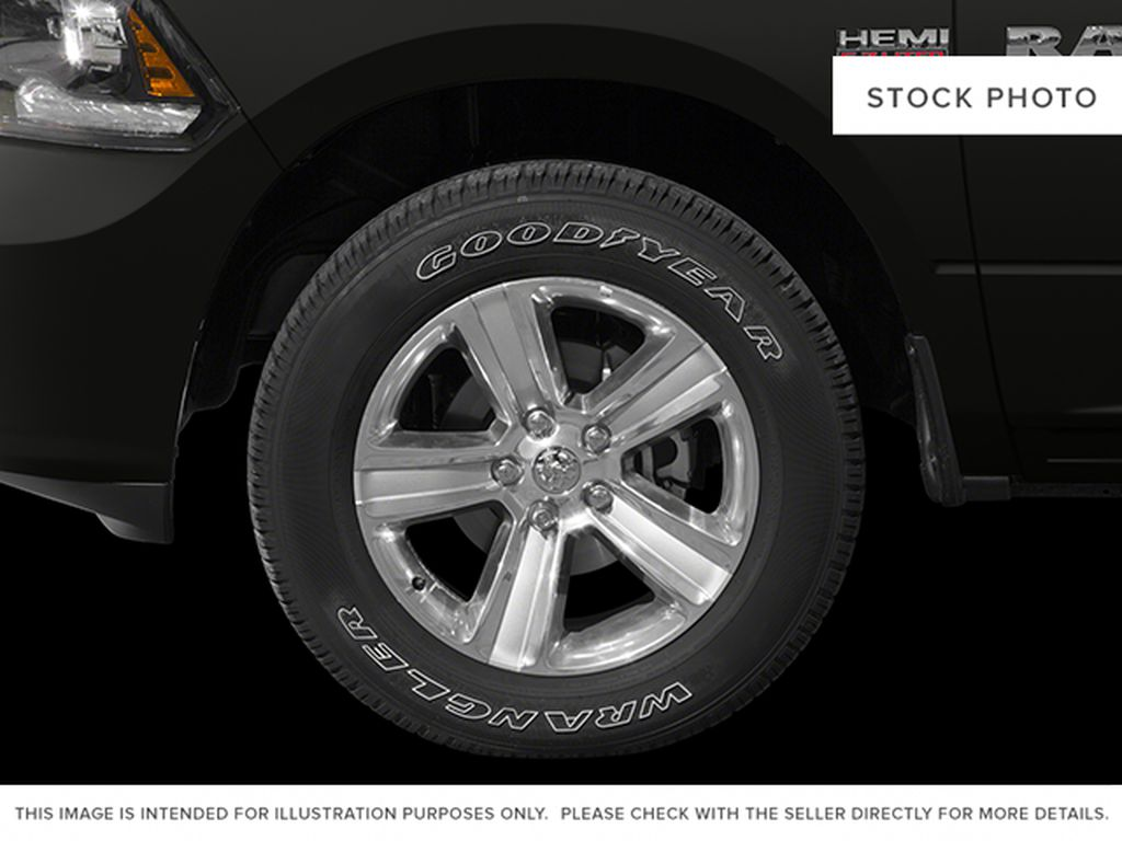 White[Bright White Clearcoat] 2014 Ram 1500 Left Front Rim and Tire Photo in Fort Macleod AB