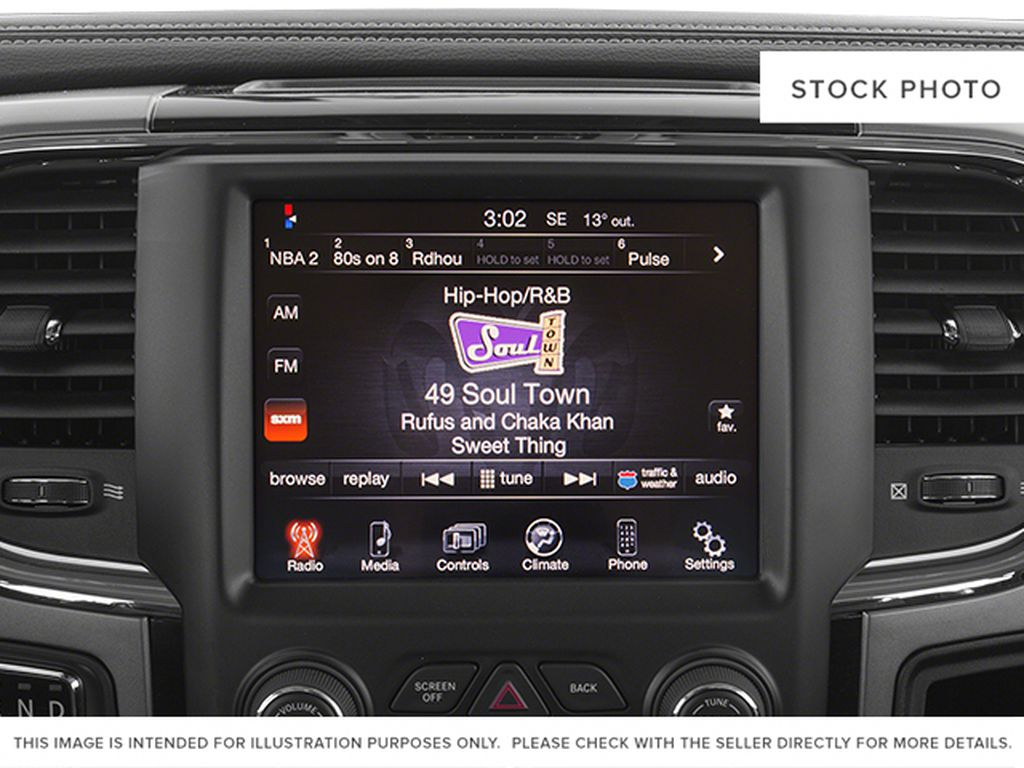 White[Bright White Clearcoat] 2014 Ram 1500 Radio Controls Closeup Photo in Fort Macleod AB