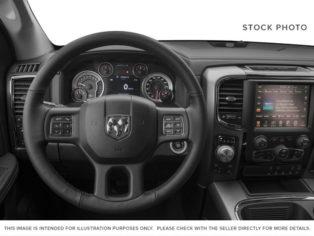 Silver[Bright Silver Metallic] 2017 Ram 1500 Steering Wheel and Dash Photo in Fort Macleod AB
