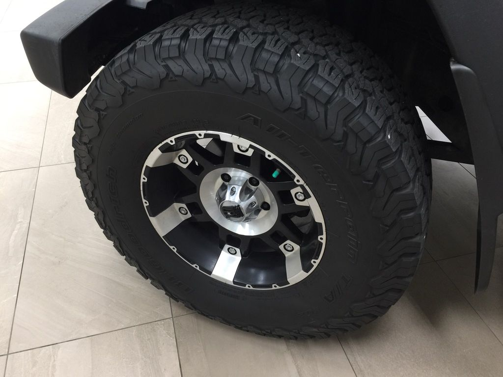 Red[Firecracker Red] 2017 Jeep Wrangler Left Front Rim and Tire Photo in Sherwood Park AB