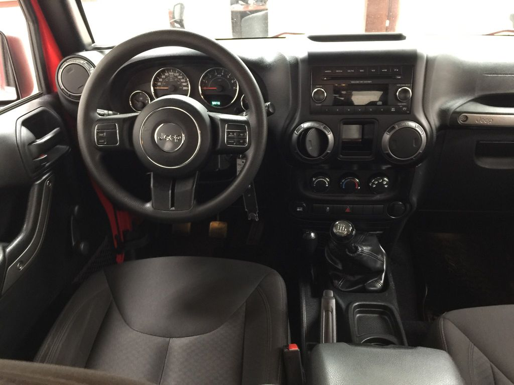 Red[Firecracker Red] 2017 Jeep Wrangler Left Front Seat Photo in Sherwood Park AB