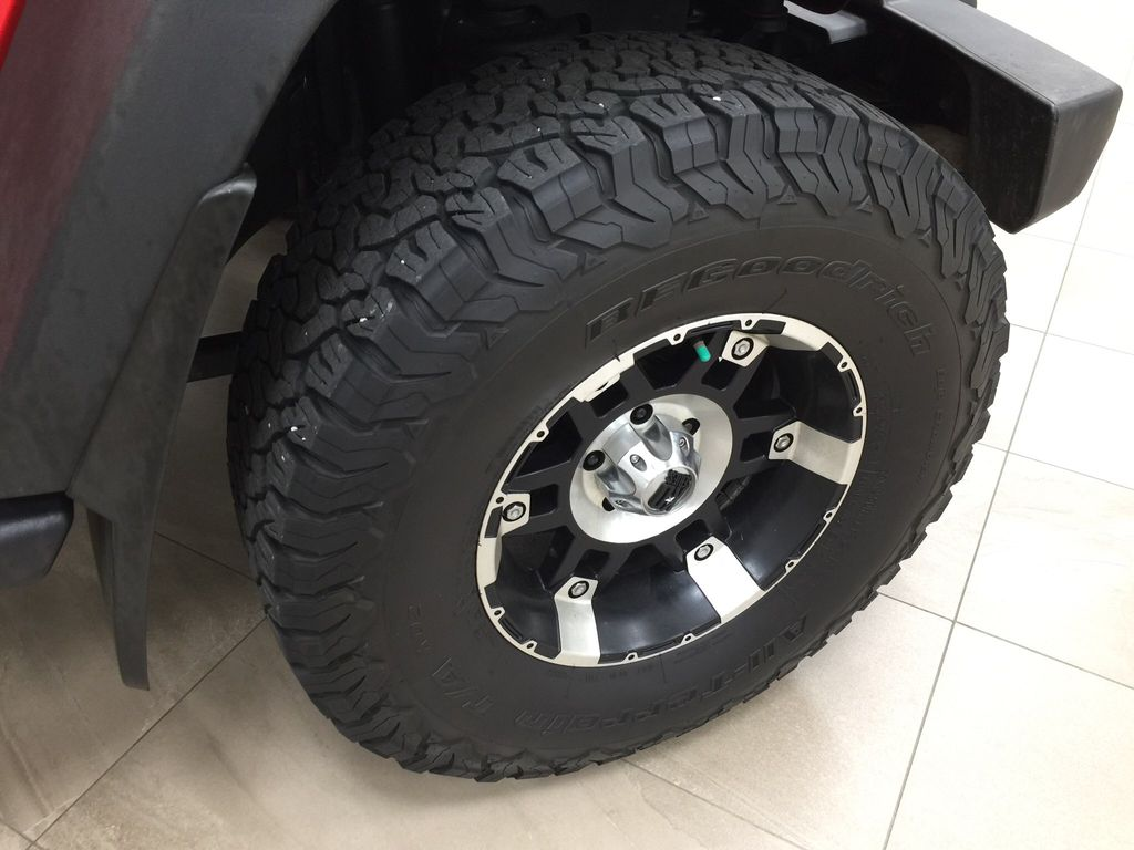 Red[Firecracker Red] 2017 Jeep Wrangler Right Front Rim and Tire Photo in Sherwood Park AB