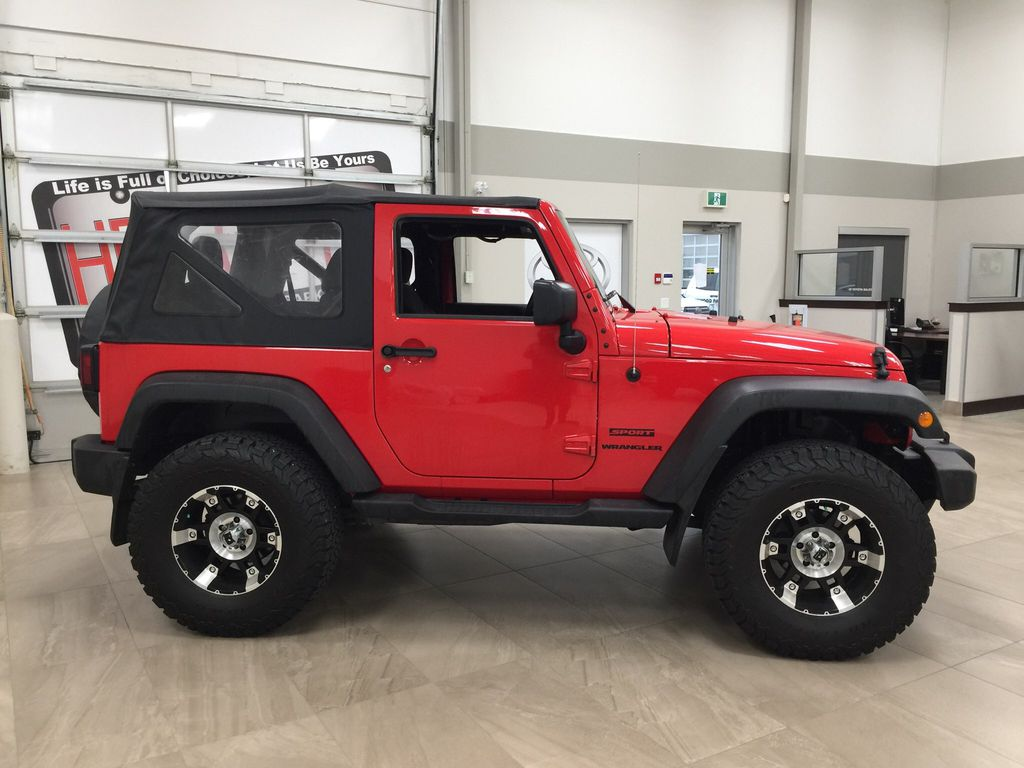 Red[Firecracker Red] 2017 Jeep Wrangler Right Side Photo in Sherwood Park AB