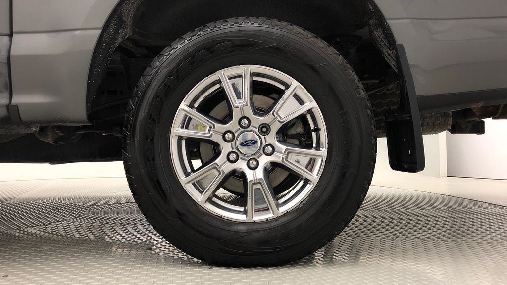 Gray[Magnetic] 2016 Ford F-150 XLT XTR 4WD - SuperCrew, V6, Running Boards Left Rear Rim and Tire Photo in Winnipeg MB