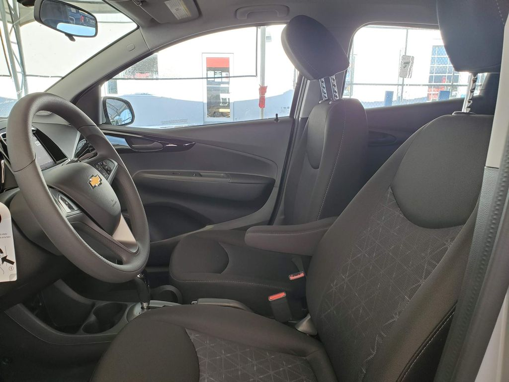 Silver 2021 Chevrolet Spark Left Front Interior Door Panel Photo in Airdrie AB