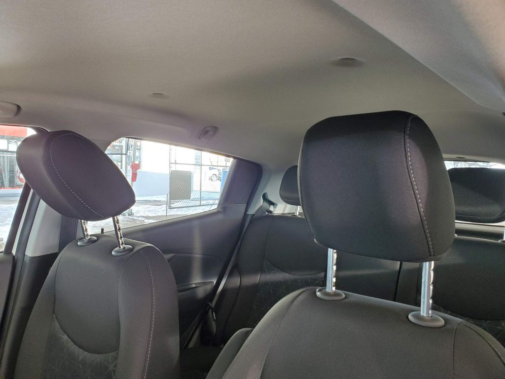 White 2021 Chevrolet Spark Driver's Side Door Controls Photo in Airdrie AB