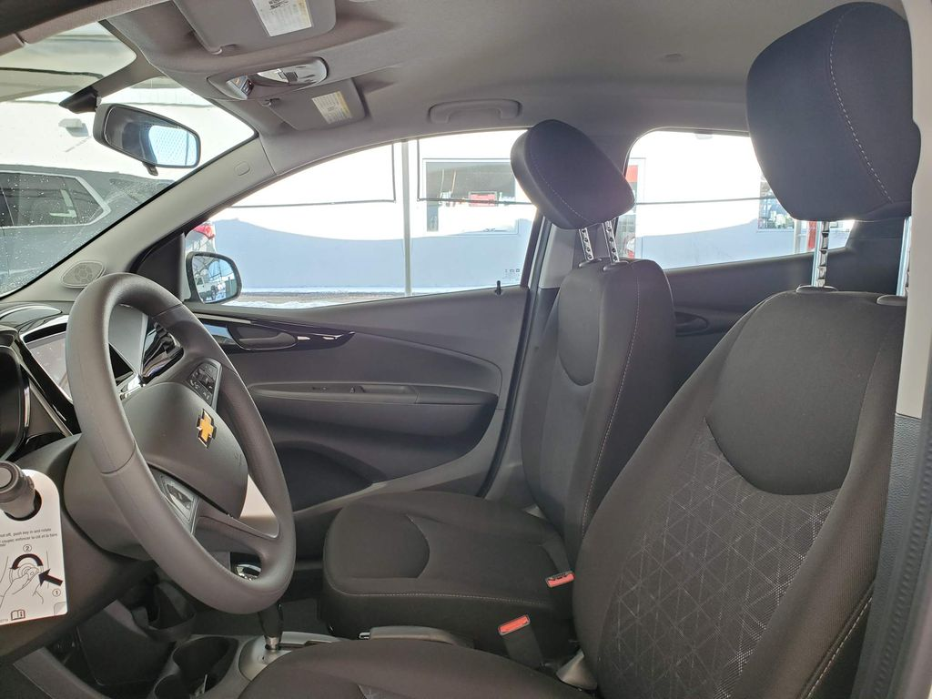 White 2021 Chevrolet Spark Left Front Interior Door Panel Photo in Airdrie AB