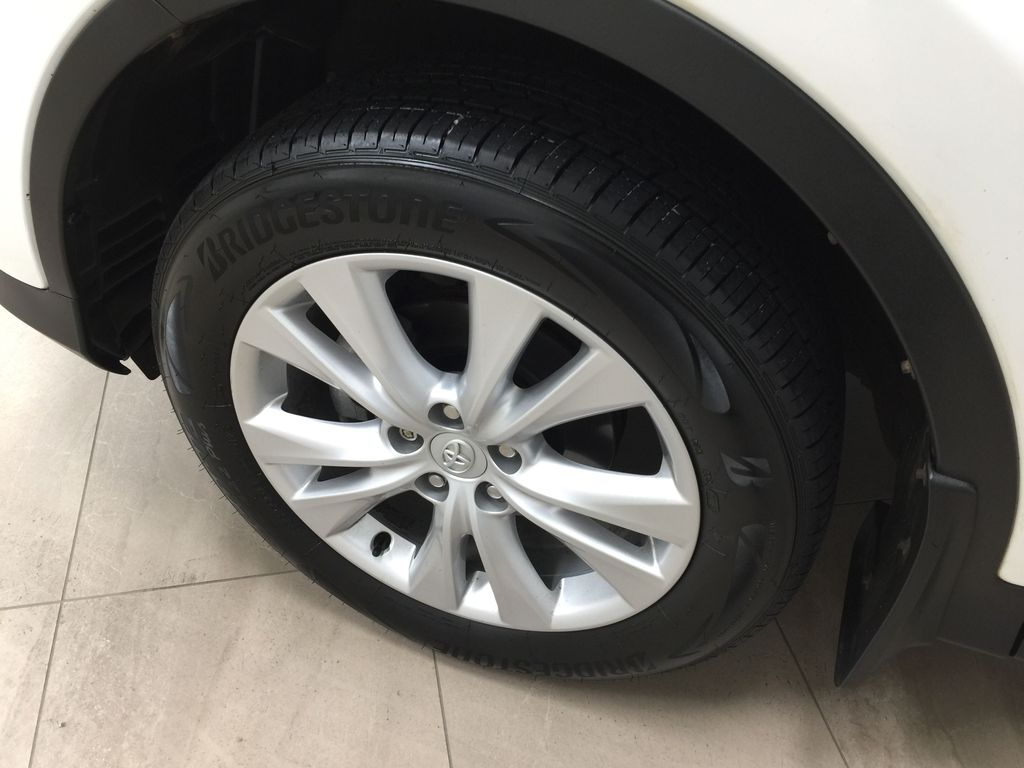 White[Blizzard Pearl] 2014 Toyota RAV4 Limited Left Front Rim and Tire Photo in Sherwood Park AB