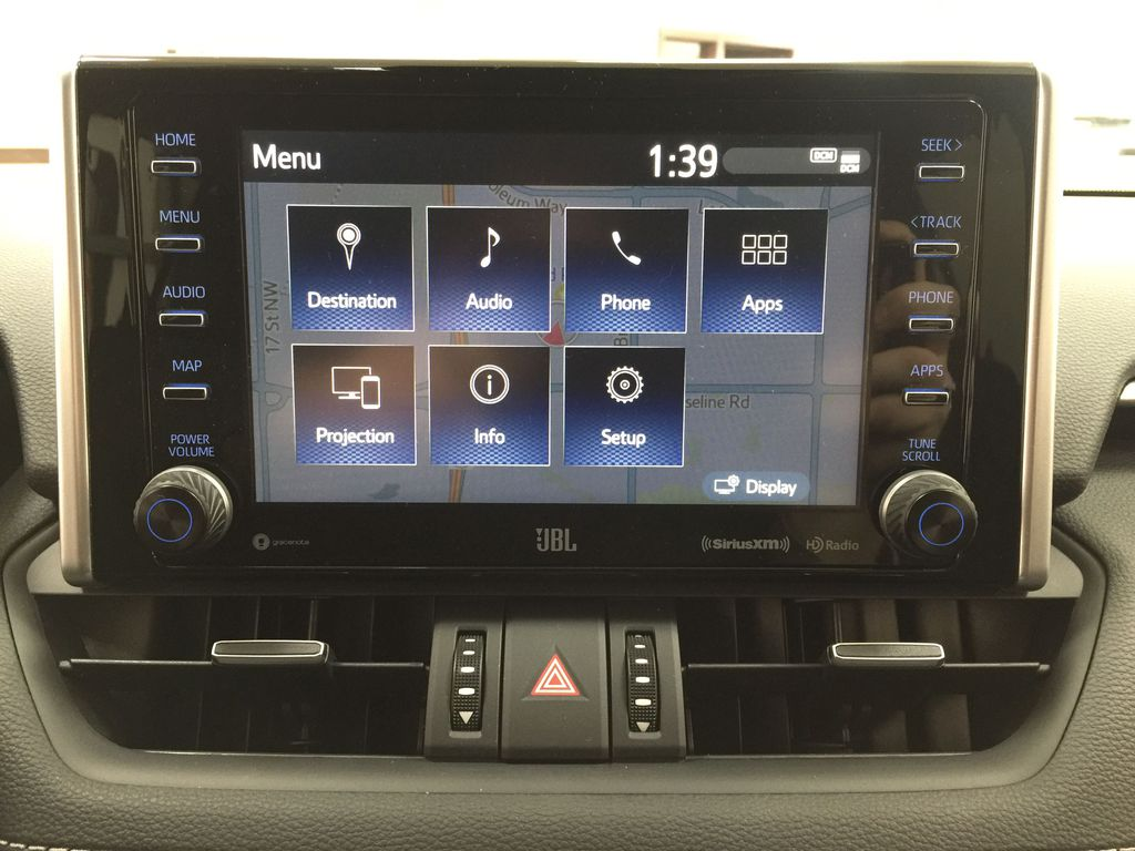 Red[Ruby Flare Pearl] 2021 Toyota RAV4 Limited Hybrid Infotainment Closeup Photo in Sherwood Park AB