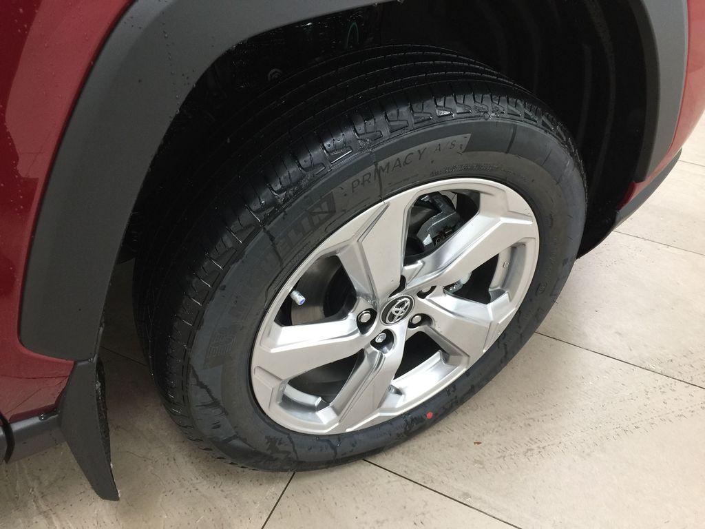 Red[Ruby Flare Pearl] 2021 Toyota RAV4 Limited Hybrid Right Front Rim and Tire Photo in Sherwood Park AB