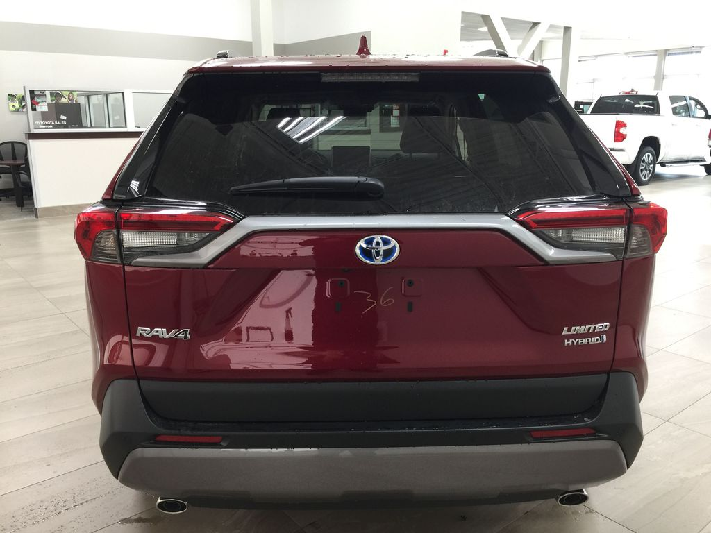 Red[Ruby Flare Pearl] 2021 Toyota RAV4 Limited Hybrid Rear of Vehicle Photo in Sherwood Park AB