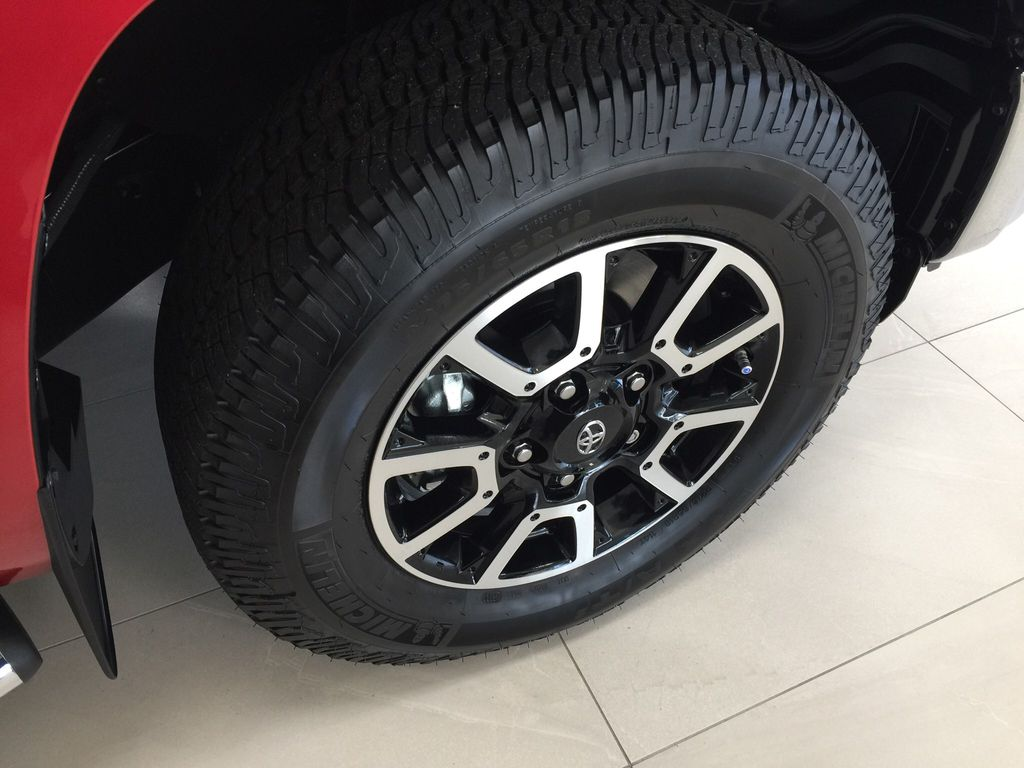 Red[Barcelona Red Metallic] 2021 Toyota Tundra TRD Off-Road Right Front Rim and Tire Photo in Sherwood Park AB