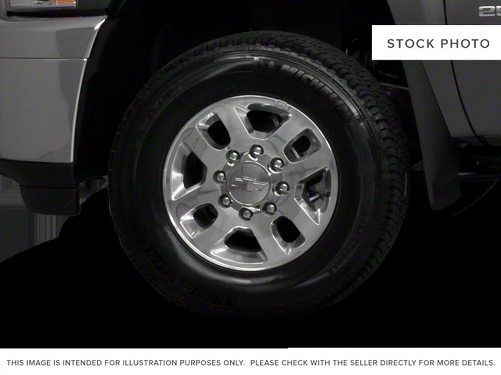 White[Summit White] 2012 Chevrolet Silverado 2500HD Left Front Rim and Tire Photo in Fort Macleod AB