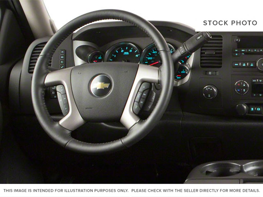 White[Summit White] 2012 Chevrolet Silverado 2500HD Steering Wheel and Dash Photo in Fort Macleod AB