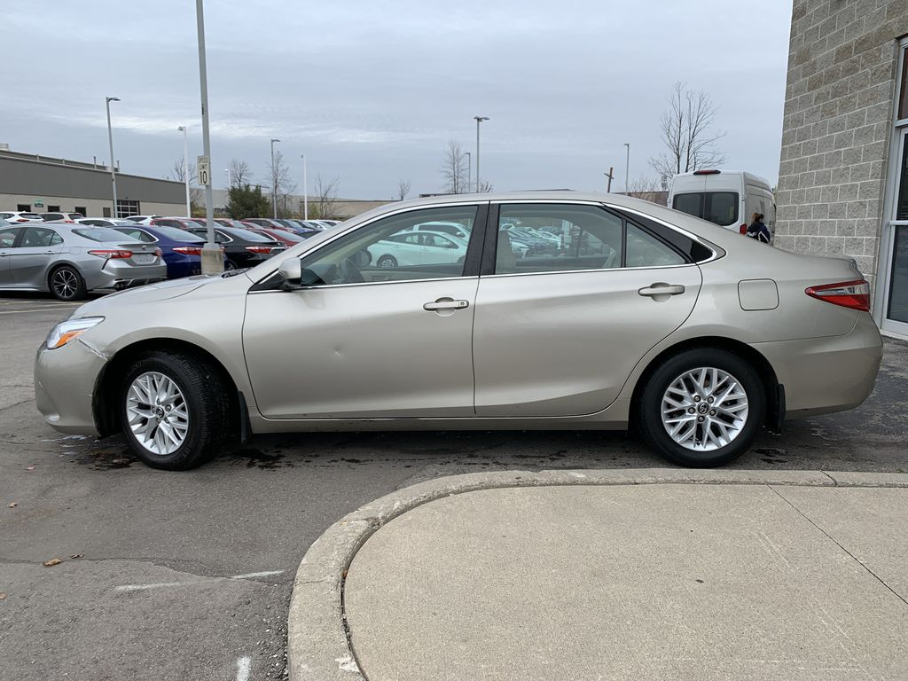 Beige 2016 Toyota Camry Left Front Rim and Tire Photo in Brampton ON