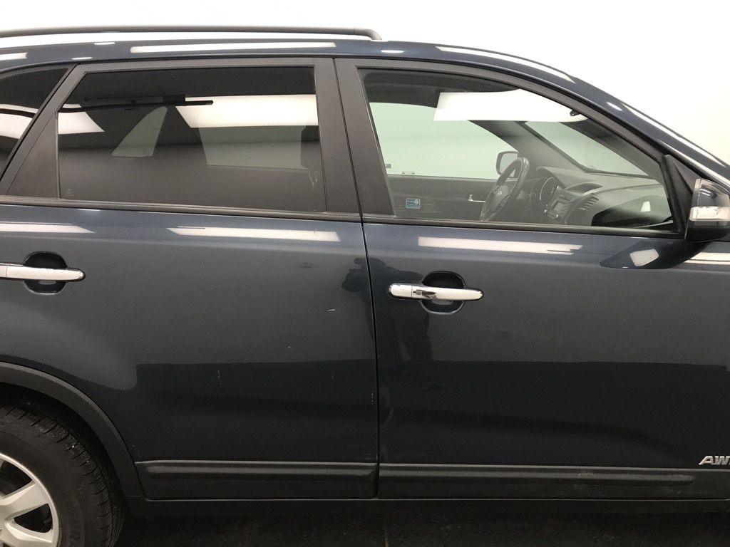 Blue 2011 Kia Sorento Left Front Interior Door Panel Photo in Lethbridge AB