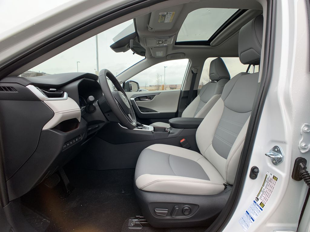 White[Blizzard Pearl] 2021 Toyota RAV4 Hybrid Limited Package DWRFVC AB Center Console Photo in Brampton ON