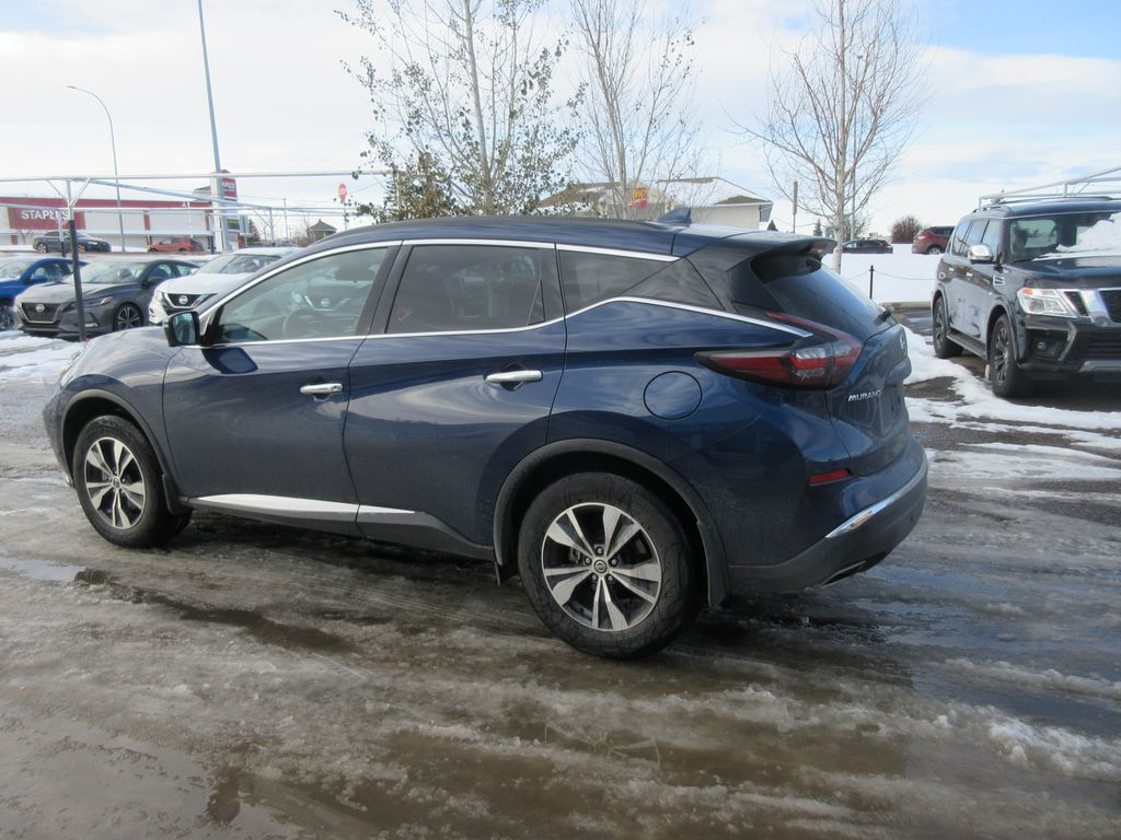 Blue[Deep Blue Pearl Metallic] 2020 Nissan Murano Steering Wheel and Dash Photo in Okotoks AB