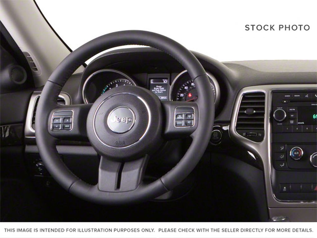 2013 Jeep Grand Cherokee Steering Wheel and Dash Photo in Fort Macleod AB