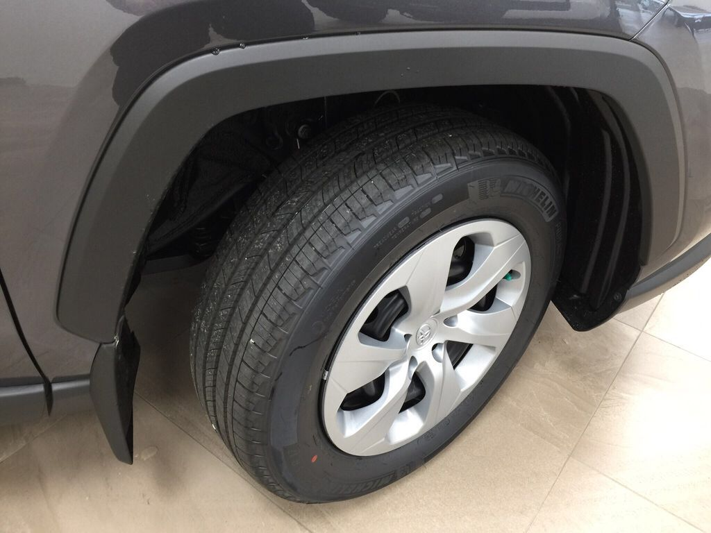 Gray[Magnetic Grey Metallic] 2021 Toyota RAV4 LE FWD Right Front Rim and Tire Photo in Sherwood Park AB