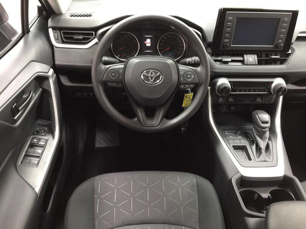 Gray[Magnetic Grey Metallic] 2021 Toyota RAV4 LE FWD Left Front Seat Photo in Sherwood Park AB