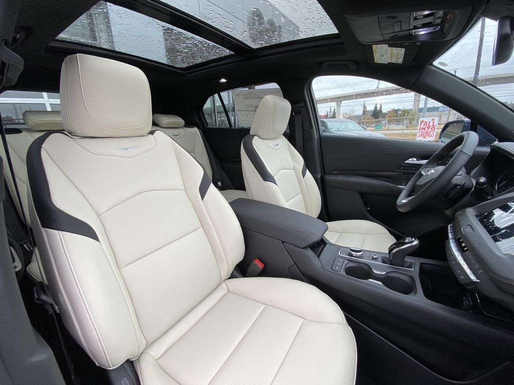 Blue[Twilight Blue Metallic] 2021 Cadillac XT4 Sport Right Side Front Seat  Photo in Calgary AB