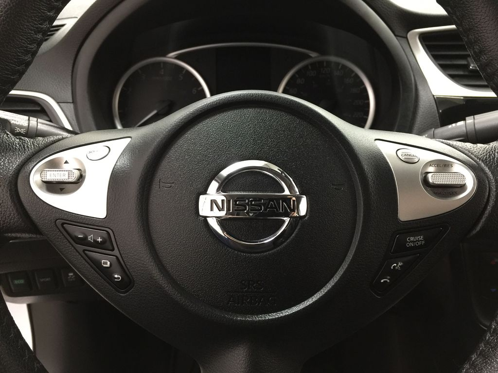 White[Aspen White Pearl] 2018 Nissan Sentra SV Steering Wheel and Dash Photo in Sherwood Park AB