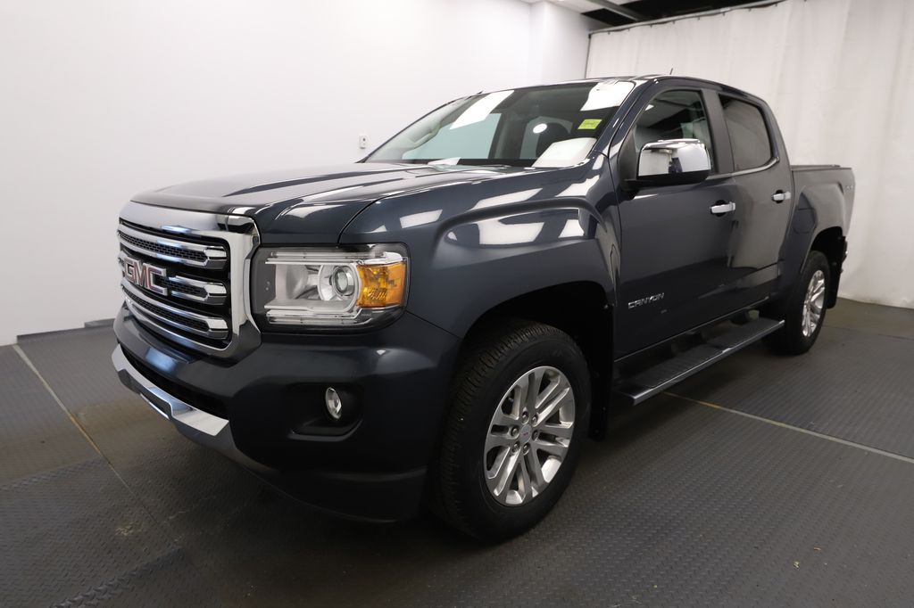 Blue 2019 GMC Canyon Left Front Head Light / Bumper and Grill in Lethbridge AB