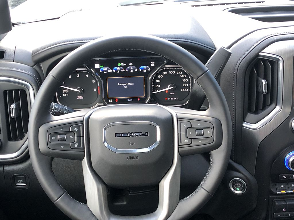 White[White Frost Tricoat] 2021 GMC Sierra 1500 Denali Strng Wheel: Frm Rear in Canmore AB