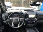 White[White Frost Tricoat] 2021 GMC Sierra 1500 Denali Strng Wheel/Dash Photo: Frm Rear in Canmore AB
