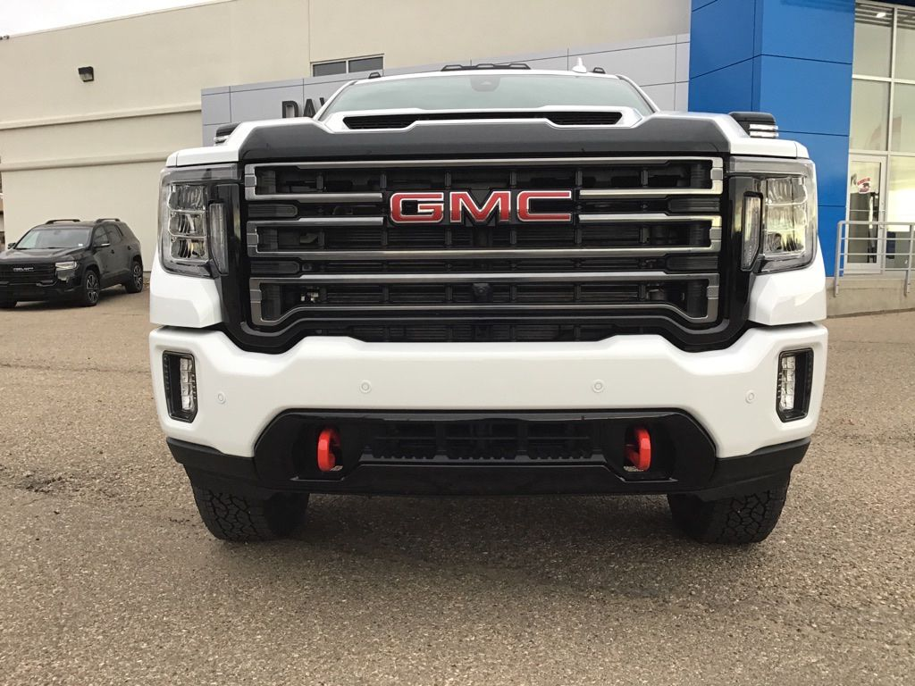 White 2021 GMC Sierra 3500HD Left Front Head Light / Bumper and Grill in Brooks AB