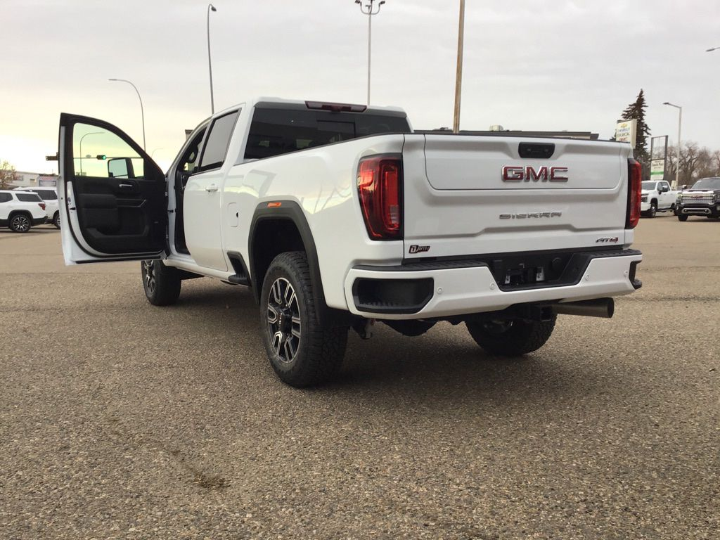 White 2021 GMC Sierra 3500HD Left Front Rim and Tire Photo in Brooks AB