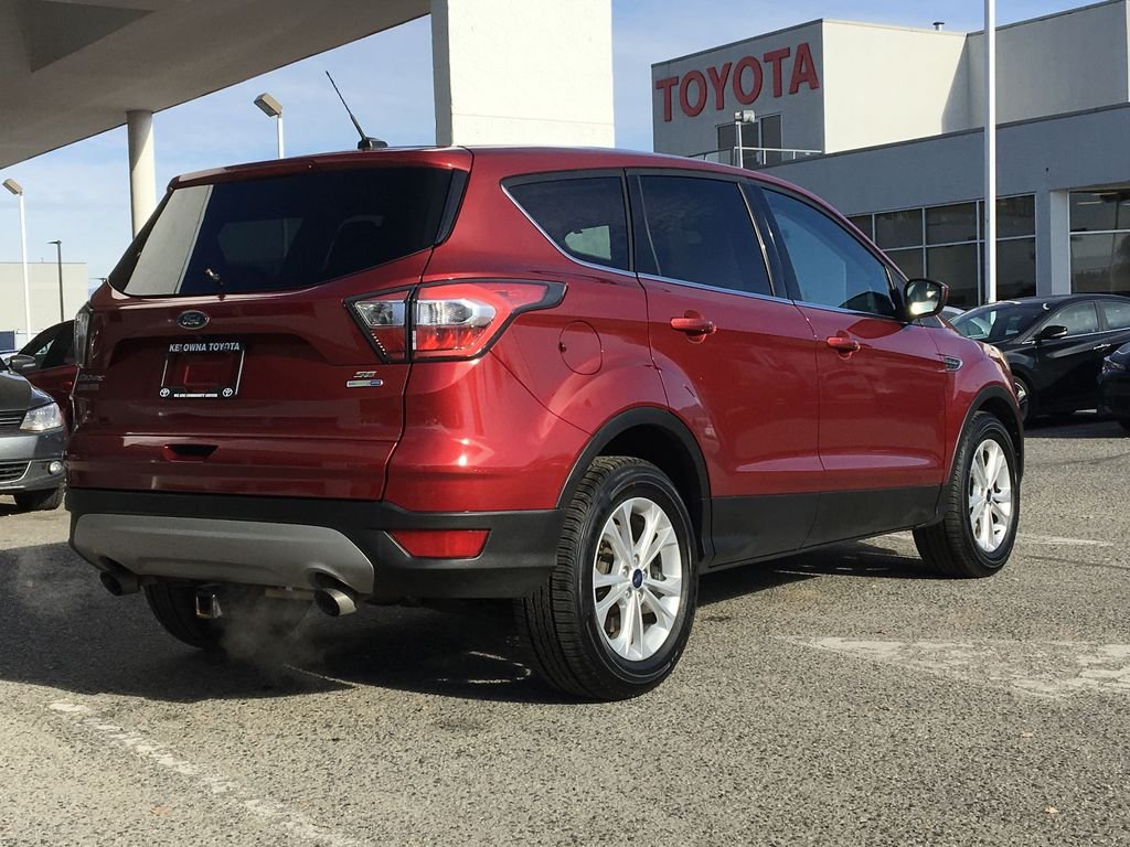 Red[Ruby Red Metallic Tinted Clearcoat] 2017 Ford Escape SE Right Rear Corner Photo in Kelowna BC