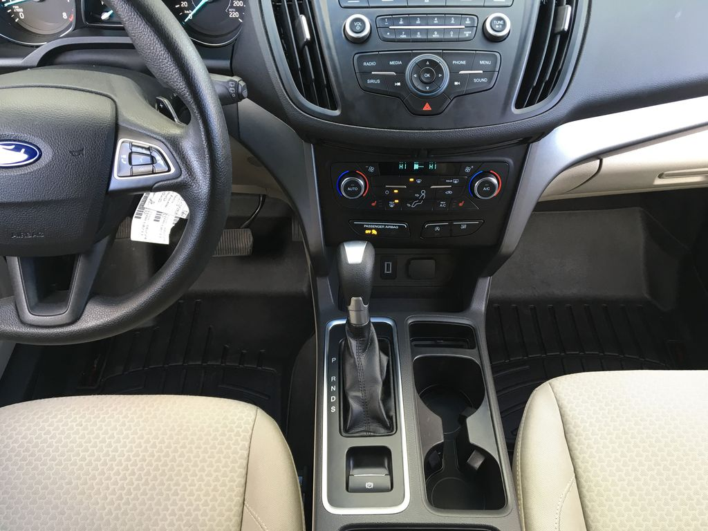 Red[Ruby Red Metallic Tinted Clearcoat] 2017 Ford Escape SE Center Console Photo in Kelowna BC