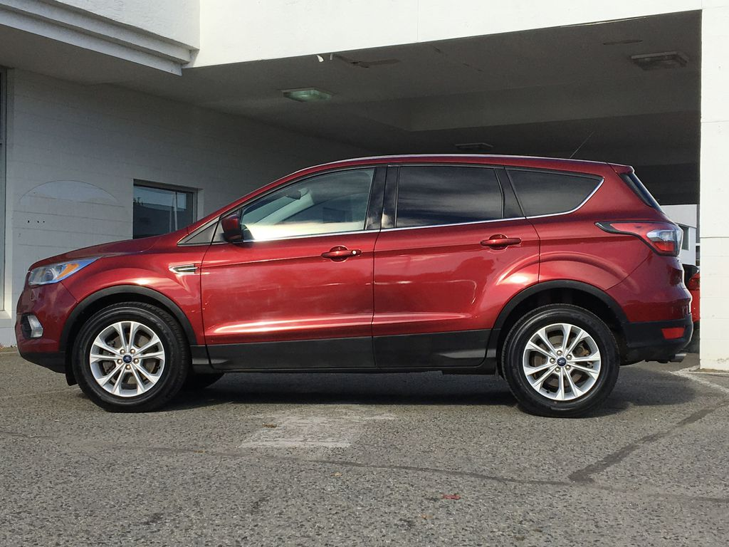 Red[Ruby Red Metallic Tinted Clearcoat] 2017 Ford Escape SE Left Side Photo in Kelowna BC