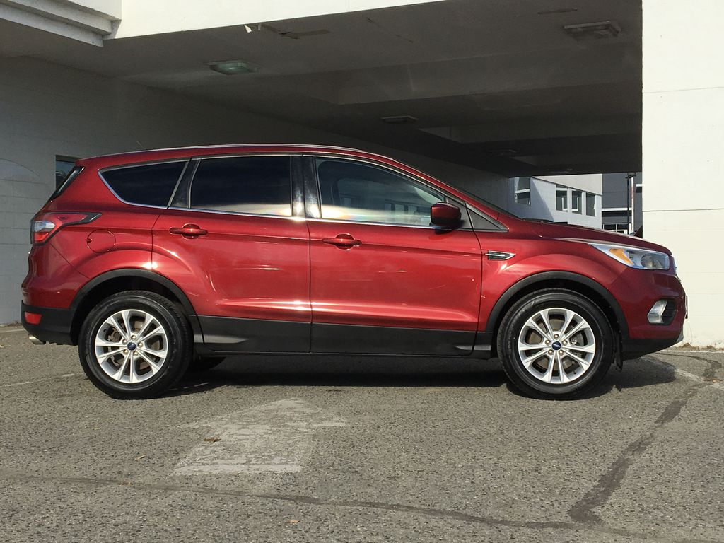 Red[Ruby Red Metallic Tinted Clearcoat] 2017 Ford Escape SE Right Side Photo in Kelowna BC