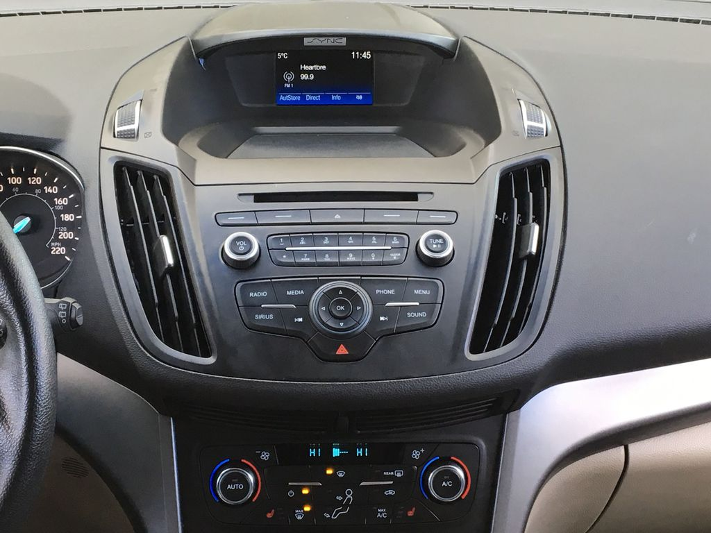 Red[Ruby Red Metallic Tinted Clearcoat] 2017 Ford Escape SE Central Dash Options Photo in Kelowna BC