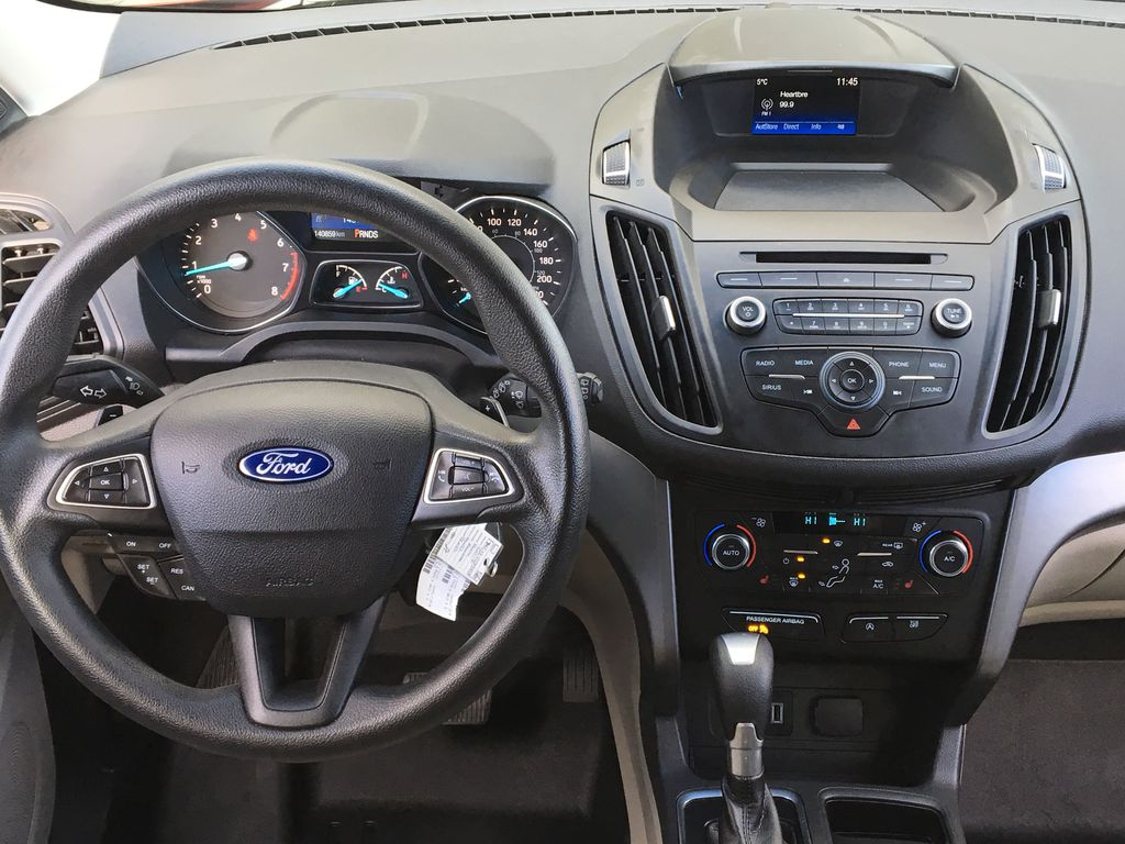 Red[Ruby Red Metallic Tinted Clearcoat] 2017 Ford Escape SE Steering Wheel and Dash Photo in Kelowna BC