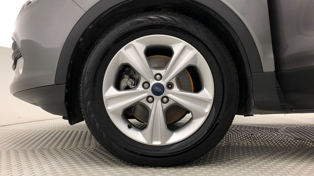 Gray[Sterling Grey Metallic] 2013 Ford Escape SE AWD - 2.0L EcoBoost, Bluetooth, SAT Radio Left Front Rim and Tire Photo in Winnipeg MB