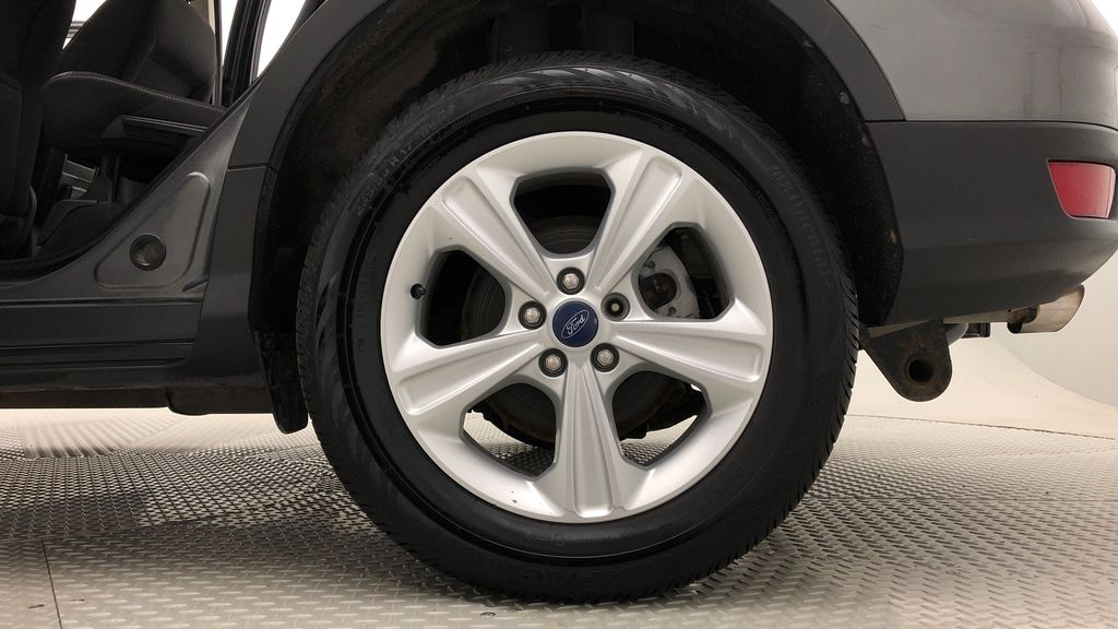 Gray[Sterling Grey Metallic] 2013 Ford Escape SE AWD - 2.0L EcoBoost, Bluetooth, SAT Radio Left Rear Rim and Tire Photo in Winnipeg MB