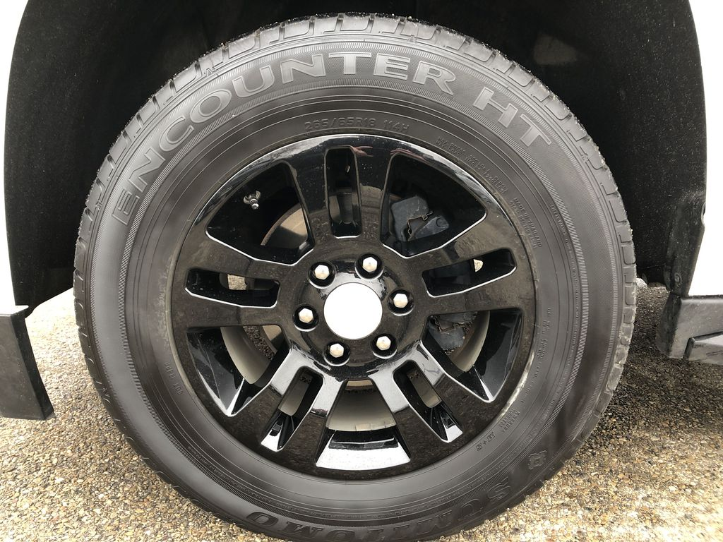 White[Summit White] 2019 Chevrolet Suburban Left Front Rim and Tire Photo in Edmonton AB