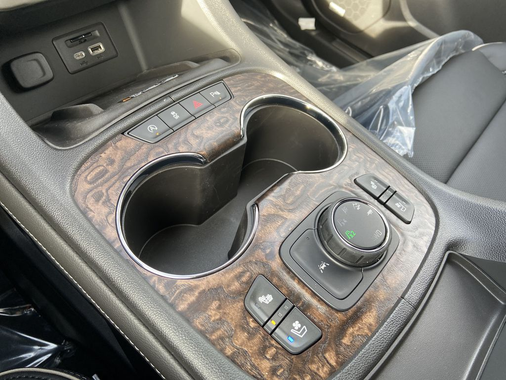 White[White Frost Tricoat] 2021 GMC Acadia Denali Center Console Photo in Calgary AB