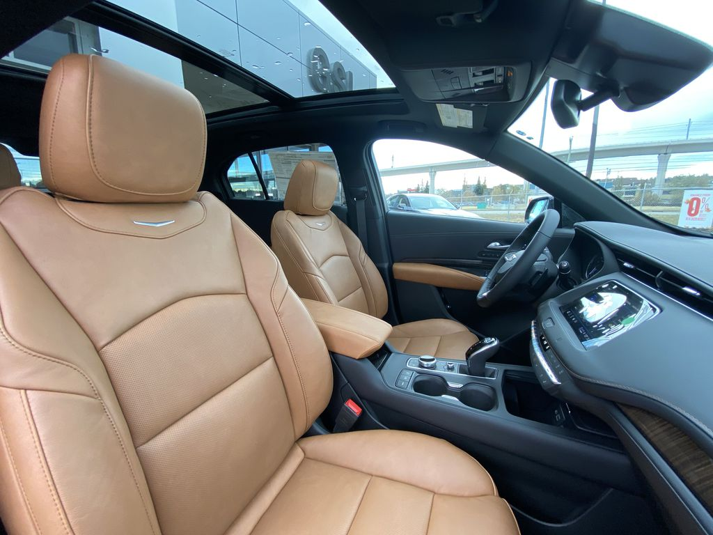 Black[Stellar Black Metallic] 2021 Cadillac XT4 Sport Right Side Front Seat  Photo in Calgary AB